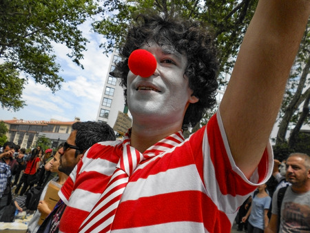 Istanbul, Turkey - June 5, 2013: Taksim Gezi Park protest the animators and clown show. A wave of demonstrations and civil unrest in Turkey began on 28 May 2013, initially to contest the urban development plan for Istanbuls Taksim Gezi Park. The protests