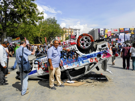 Istanbul, Turkey - June 5, 2013: Taksim Square burned a police vehicle. A large portion of Turkey It spreads. A wave of demonstrations and civil unrest in Turkey began on 28 May 2013, initially to contest the urban development plan for Istanbuls Taksim G
