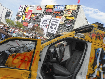 Istanbul, Turkey - June 5, 2013: A television channel broadcast vehicle damaged in Taksim square. wave of Demonstrations and civil unrest in Turkey beg on 28 May 2013. Initially to contest the urban development plan for Istanbuls Taksim Gezi Park. The pr
