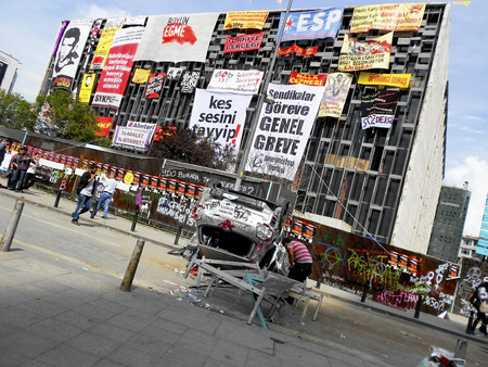 fawkes: Istanbul, Turkey - June 5, 2013: Front side covered with banners of Ataturk Cultural Center. It has StartEd action against the construction of a shopping center instead of cutting trees in Gezi Park in Istanbul. It spreads a large portion of Turkey. A wav
