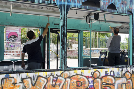 Istanbul, Turkey - June 9, 2013: Unknown persons damaged the paint public tools. Gezi Park protests. Damaged public bus being used as barricade. A wave of Demonstrations and civil unrest in Turkey beg on 28 May 2013. Initially to contest the urban develop