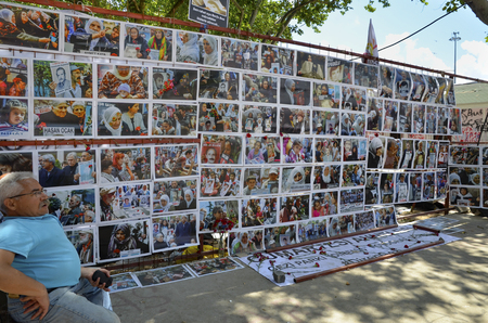 Istanbul, Turkey - June 9, 2013:  Saturday Mothers Gezi Park resistance Photography exhibition. The Saturday Mothers (Cumartesi Anneleri) is a group who gathers 12pm every Saturday for half an hour at Galatasaray (district), Istanbul (Turkey), holding pho
