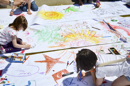 Istanbul, Turkey - June 9, 2013:  In protest area under the supervision of their parents children who work in paint. A wave of demonstrations and civil unrest in Turkey began on 28 May 2013, initially to contest the urban development plan for Istanbuls T