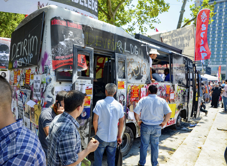 guy fawkes mask: Istanbul, Turkey - June 9, 2013:  Gezi Park protests.  Damaged public police bus being used as place.  A wave of demonstrations and civil unrest in Turkey began on 28 May 2013, initially to contest the urban development plan for Istanbuls Taksim Gezi Par Editorial