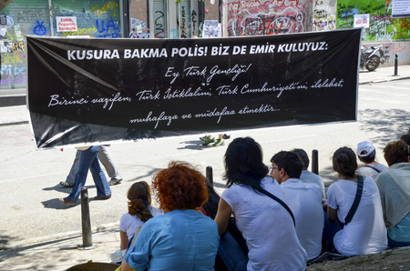 Istanbul, Turkey - June 9, 2013: Demonstrators in the trip to the park Ataturk to Youth is seen on posters. Ataturk addressed the poster writes, Ankara, October 20, 1927: Turkish Youth! Your first duty is to preserve and to defend Turkish Independence  Editorial