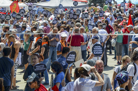 outrage: Istanbul, Turkey - June 9, 2013: A wave of demonstrations and civil unrest in Turkey began on 28 May 2013, initially to contest the urban development plan for Istanbuls Taksim Gezi Park. The protests were sparked by outrage at the violent eviction of a s
