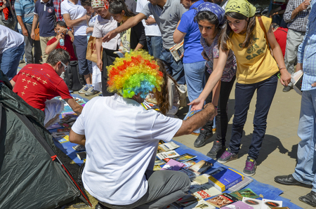 Istanbul, Turkey - June 9, 2013: Taksim Gezi Park protests and events. Marauder Library, Grant brought books and free books are distributed. wave of Demonstrations and civil unrest in Turkey beg on 28 May 2013. Initially to contest the urban development p Editorial