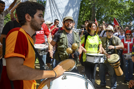 fawkes: Istanbul, Turkey - June 9, 2013: Taksim Gezi Park, which support the protesters marching band music.The sit-in at Taksim Gezi Park was restored after police withdrew from Taksim Square on 1 June, 2013 and developed into an Occupy-like camp, with thousands