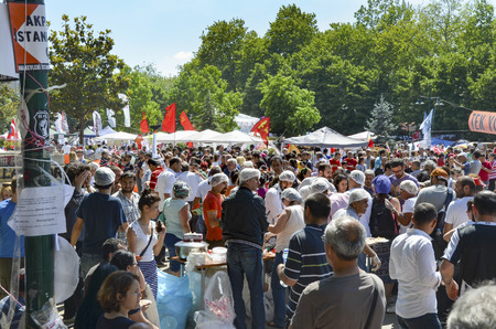 food distribution: Istanbul, Turkey - June 9, 2013: Taksim Gezi Park protest free food distribution in the area, Experiencing great stampede.t has StartEd action against the construction of a shopping center instead of cutting trees in Gezi Park in Istanbul. A large portion