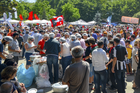 food distribution: Istanbul, Turkey - June 9, 2013: Taksim Gezi Park protest free food distribution in the area,  Experiencing great stampede.t has StartEd action against the construction of a shopping center instead of cutting trees in Gezi Park in Istanbul. A large portio Editorial