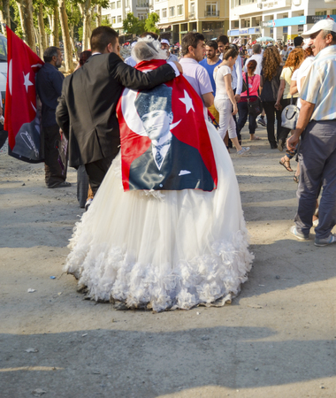 Istanbul, Turkey - June 9, 2013: Newly married couple in the protest area, the bride and groom. A wave of Demonstrations and civil unrest in Turkey beg on 28 May 2013. Initially to contest the urban development plan for Istanbuls Taksim Gezi Park. The pr Editorial