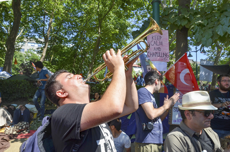 Istanbul, Turkey - June 9, 2013: Taksim Gezi Park, which support the protesters marching band music. The sit-in at Taksim Gezi Park was restored after police withdrew from Taksim Square on 1 June, 2013 and developed into an Occupy-like camp, with thousand Editorial