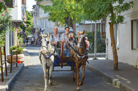 Istanbul, Turkey - September 29, 2013: Coachman Horse Carriage Ride. Buyukada, Princes' Islands, also known as Istanbul is the largest to the islands off of the coast. Buyukada motor vehicle is not being used, such as the Phaeton carriage taxi service is.