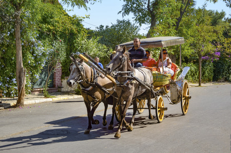 Istanbul, Turkey - September 29, 2013: Coachman Horse Carriage Ride. Buyukada, Princes' Islands, also known as Istanbul is the largest to the islands off of the coast. Buyukada motor vehicle is not being used, such as the Phaeton carriage taxi service is. Editorial