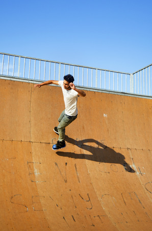 blading: Istanbul, Turkey - June 4, 2016: Avcilar Skatepark. In the area of 2000 square meters skatepark, young skaters under the blue sky seems almost like flying. Editorial