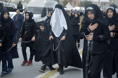 mourne: Istanbul, Turkey - November 3, 2014: Universal Ashura Mourning Ceremony. Ashura. Universal Day of Ashura Mourne Ceremonyâ was held in Istanbul to commemorate the martyrdom of Husain ibn Ali, the grandson of the Prophet Muhammad and his 71 friends.
