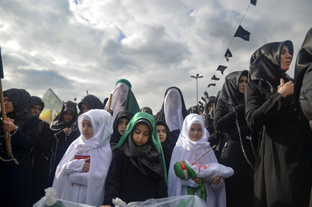 mourne: Istanbul, Turkey - November 3, 2014: Universal Ashura Mourning Ceremony. Ashura. Universal Day of Ashura Mourne Ceremonyâ was held in Istanbul to commemorate the martyrdom of Husain ibn Ali, the grandson of the Prophet Muhammad and his 71 friends. Editorial