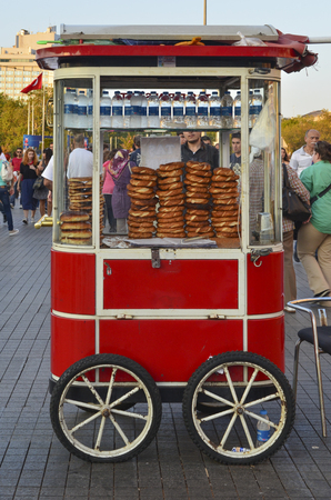 turkish bread: Istanbul, Turkey -September 9, 2012: A vendor sells simit, a type of Turkish bread, in the streets of Istanbul.