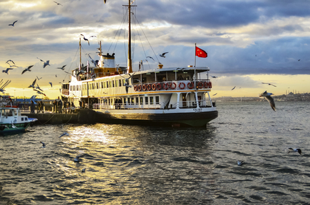 millennia: Istanbul, Turkey - January 19, 2013:  Ferries in Istanbul. Boats have traversed the waters of the Bosphorus for millennia and until the opening of the first Bosphorus bridge in 1973, were the only mode of transport between the European and Asian halves of