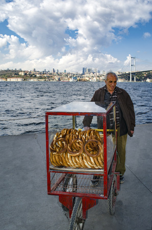 turkish bread: Istanbul, Turkey - March 10, 2013: A vendor sells simit, a type of Turkish bread, in the streets of Istanbul.