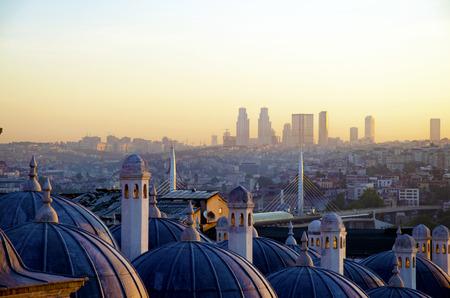 Sultan Suleiman (Suleymaniye) Madrasah (Rabi) metro bridge across the Golden Horn and the sunrise view of Istanbul Stock Photo