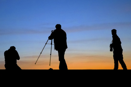 documenting: Sunrise silhouette of photographers shooting