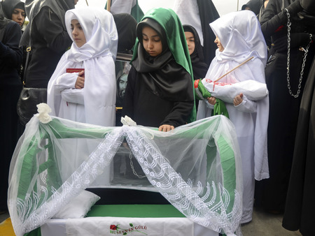 mourne: Istanbul, Turkey - November 3, 2014: Universal Ashura Mourning Ceremony. Mourne ashura. Universal Day of Ashura Ceremony, was held in Istanbul to commemorate the martyrdom of Husain ibn Ali, the grandson of the Prophet Muhammad and his 71 friends.