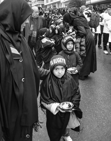 azeri: Istanbul, Turkey - November 13, 2013: The global mourning ceremony of Ashura. Karbala Martyrs Commemoration in Arenamega. Thousands of Jaferies in Turkey joined the Karbala mourning ritual where Prophet Muhammads grandson Imam Hussain and 72 others were  Editorial