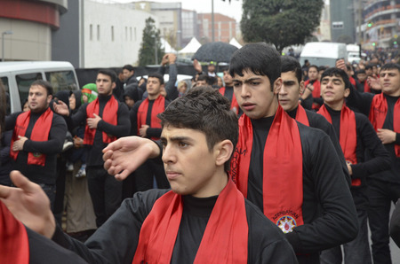 hz: Istanbul, Turkey - November 13, 2013: The global mourning ceremony of Ashura. Azerbaijan Hz. Imam Hussain Group. Karbala Martyrs Commemoration in Arenamega. Thousands of Jaferies in Turkey joined the Karbala mourning ritual where Prophet Muhammads grands