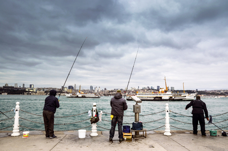 salinity: Istanbul, Turkey - December 4, 2013: Bosphorus Fishing Istanbul. Istanbul Asian side of the photo seen people fishing in the Uskudar district. In Istanbul,  particularly the differences in temperature and salinity between the Black Sea and the Mediterrane