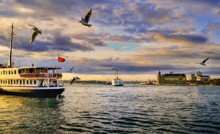 Istanbul, Turkey - January 19, 2013:  Istanbul throat historic Haydarpasa train station and the ferry.  Ferries in Istanbul commuter ferries have been operating on the Bosphorus since 1851. Boats have traversed the waters of the Bosphorus for millennia an Editorial