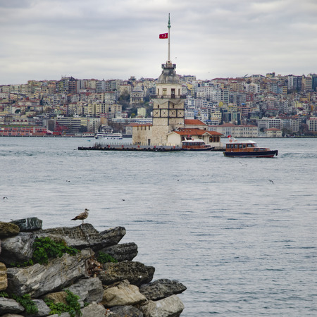 The Maidens Tower (Turkish: Kiz Kulesi), also known as Leanders Tower since the medieval Byzantine period, is a tower lying on a small islet located at the southern entrance of the Bosphorus strait 200 m from the coast of Uskudar in Istanbul, Turkey.