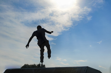 skaters: Young skaters under the blue sky seems almost like flying. Stock Photo