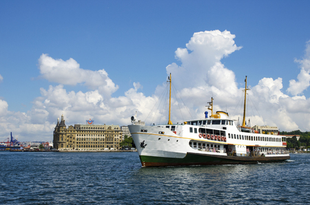 Istanbul throat historic Haydarpasa train station and ferry under white clouds