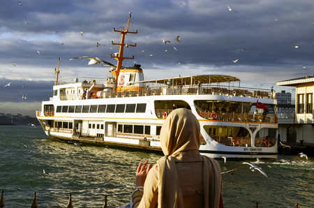 koy: Istanbul, Turkey - January 19, 2013: Istanbul Ferries  (called vapur in Turkish) continue to serve as a key public transport link for many Thousands of commuters, tourists and vehicles per day. Editorial