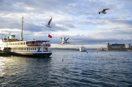 Turkey,  Istanbul views. Throat historic Haydarpasa train station and the ferry.  Ferries in Istanbul commuter ferries have been operating on the Bosphorus since 1851. Boats have traversed the waters of the Bosphorus for millennia and until the opening of Stock Photo