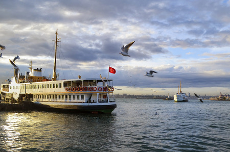 Turkey, Istanbul throat historic Haydarpasa train station and the ferry.  Ferries in Istanbul commuter ferries have been operating on the Bosphorus since 1851. Boats have traversed the waters of the Bosphorus for millennia and until the opening of the fir Stock Photo