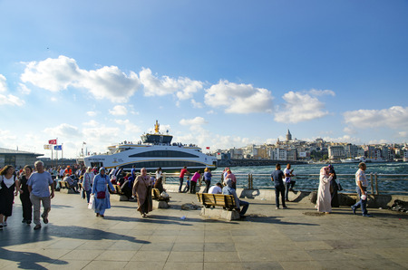 appears: Istanbul, Turkey - July 26, 2016: Istanbul Eminonu pier and new types of boats. The symbol of Istanbul Galata bridge and Galata tower appears Istanbul views