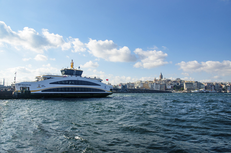 occur: Istanbul, Turkey - July 26, 2016: Istanbul Eminonu pier and new types of boats. The symbol of Istanbul Galata bridge and Galata tower appears Istanbul views