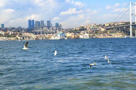 koprusu: View of the European side of Istanbul from the Bosphorus. The Bosphorus Bridge (Turkish: Bogazici Koprusu), also called the First Bosphorus Bridge, is one of two suspension bridges spanning the Bosphorus strait (Turkish: Bogazici) in Istanbul, Turkey; thu