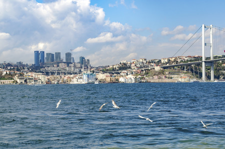 bogazici: View of the European side of Istanbul from the Bosphorus. The Bosphorus Bridge (Turkish: Bogazici Koprusu), also called the First Bosphorus Bridge, is one of two suspension bridges spanning the Bosphorus strait (Turkish: Bogazici) in Istanbul, Turkey; thu