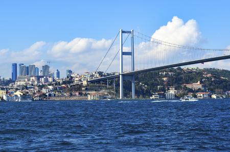 koprusu: Istanbul, Turkey - View of the European side of Istanbul from the Bosphorus. The Bosphorus Bridge (Turkish: Bogazici Koprusu), also called the First Bosphorus Bridge, is one of two suspension bridges spanning the Bosphorus strait (Turkish: Bogazici) in Is