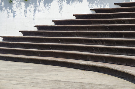 surrounds: Stairs Architecture background. flat and circular staircase that surrounds a large area