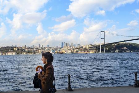 Istanbul, Turkey - March 10, 2013: View of the European side of Istanbul from the Bosphorus. The Bosphorus Bridge (Turkish: Bogazici Koprusu), also called the First Bosphorus Bridge (Turkish: 1. Bogazici Koprusu) or First Bridge (Turkish: Birinci Kopru),  Editorial