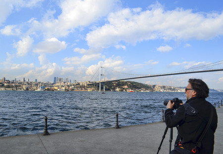 bogazici: Istanbul, Turkey - March 10, 2013: Istanbul Strait views. A photographer landscape viewing. Against the European side of Istanbul coast, visible in the background 15 July martyrs bridge Editorial