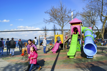 bogazici: Istanbul, Turkey - March 10, 2013: Spring season, people Istanbul Strait on the beach enjoying the spring. The Bosphorus Bridge (Turkish: Bogazici Koprusu), also called the First Bosphorus Bridge, is one of two suspension bridges spanning the Bosphorus st