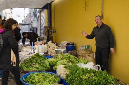 sunday market: Istanbul, Turkey - March 31, 2013: Istanbul, Balat. Inebolu (Kastamonu) district bazaar. When compared to other pazar (markets), Kastamonu can seem a little challenging. Like others, this market sets up shop on a small street once a week, every Sunday in  Editorial