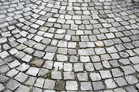 road surface: Old cobblestones road surface (Albanian sidewalk) background Stock Photo