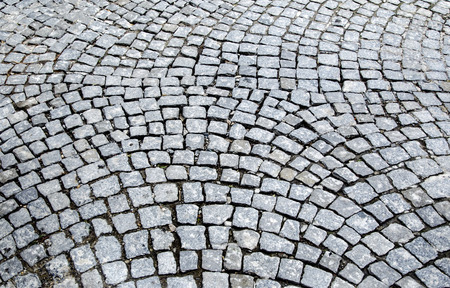 cobblestones: Old cobblestones road surface (Albanian sidewalk) background Stock Photo