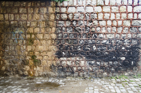 Historic stone walls, decorated with cement and paint. Background-Texture